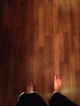 Brian Penny feet on wood floor